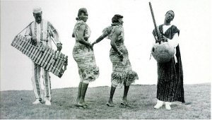 kora and balafon and dancers